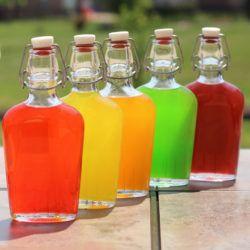 Skittles Vodka in flasks on patio table