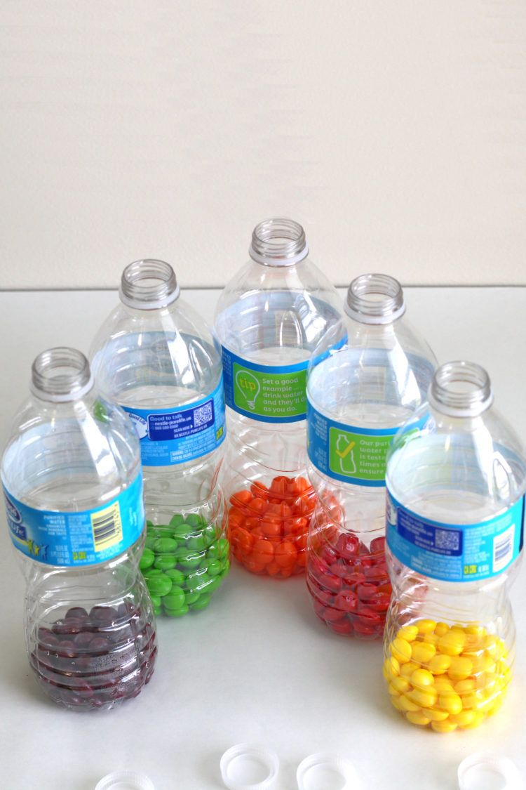 Skittles separated by flavor in empty bottles