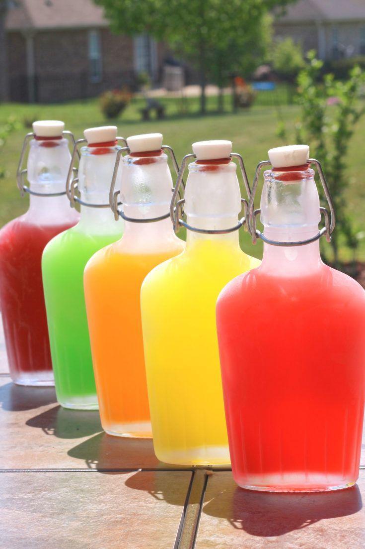 Skittles Vodka in flasks on patio