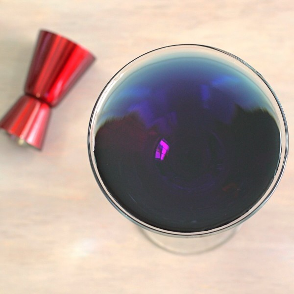 "The Prison Blues cocktail was the result of falling in love with Creme de Violette while binge watching ""Making a Murderer."" Hey, you need a cocktail after that show. Two versions: Guilty and Not Guilty."