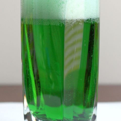 Green beer in glass