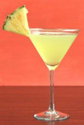 Bright yellow Cabo drink with pineapple wedge