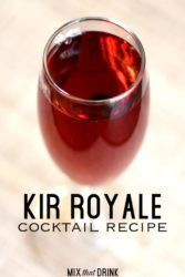 Kir Royale cocktail served in champagne flute on wooden bar top