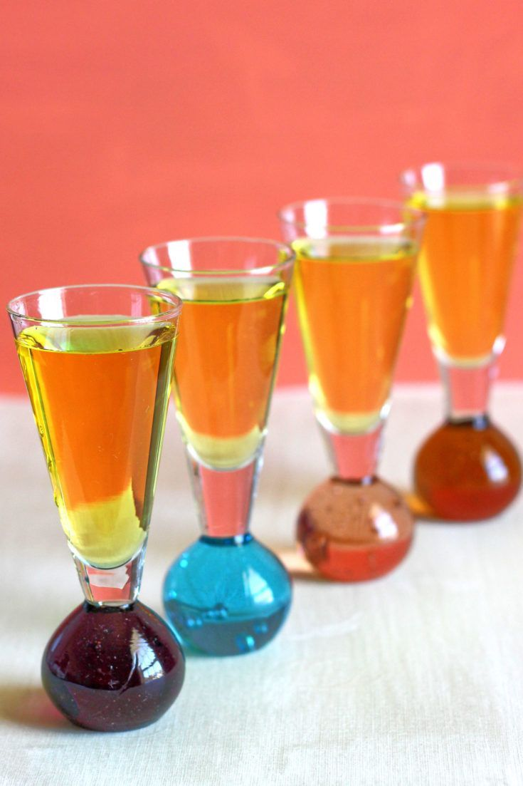 Four Sunny Mexico drinks lined up against an orange background