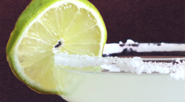 Closeup of classic margarita cocktail with lime
