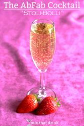 Overhead view of AbFab cocktail in champagne flute with strawberries