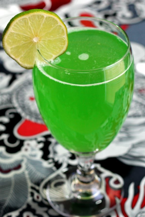 Bright green cocktail with lime slice