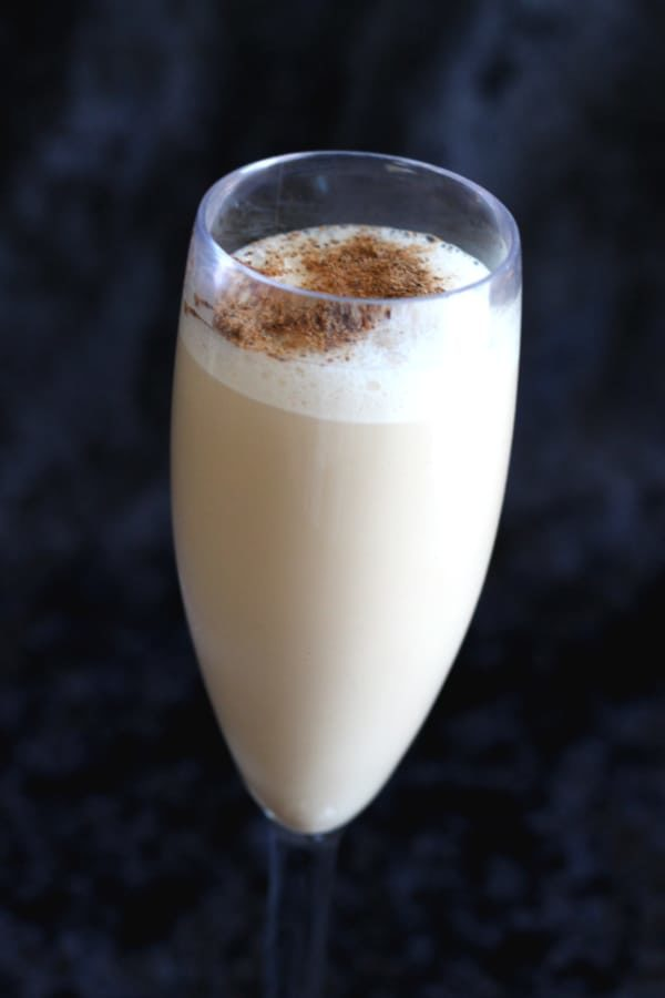 Creamy white cocktail with nutmeg sprinkled on top