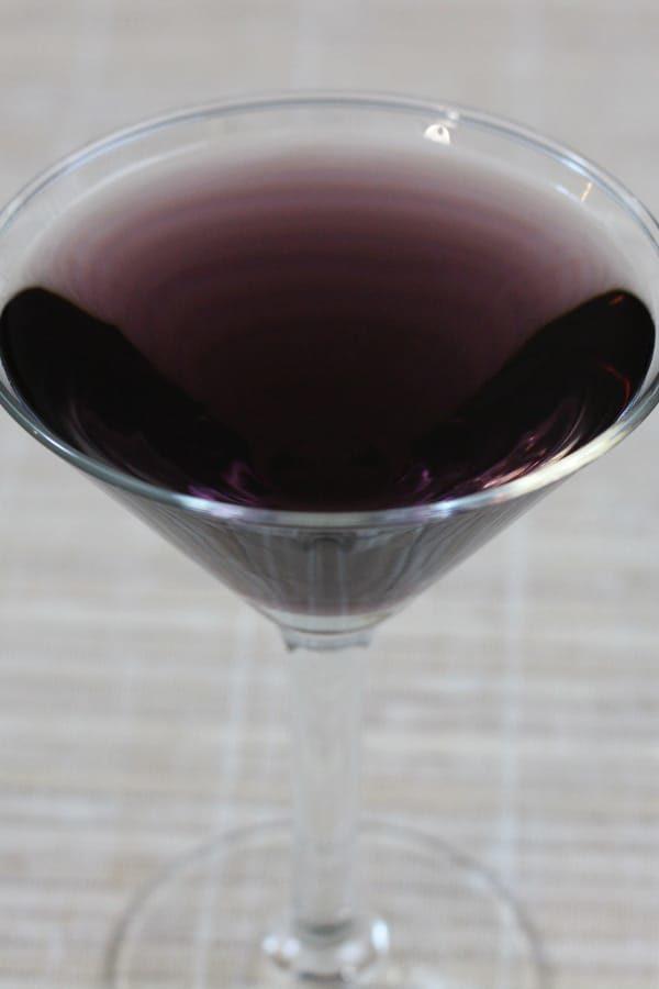 Dark purple cocktail in martini glass
