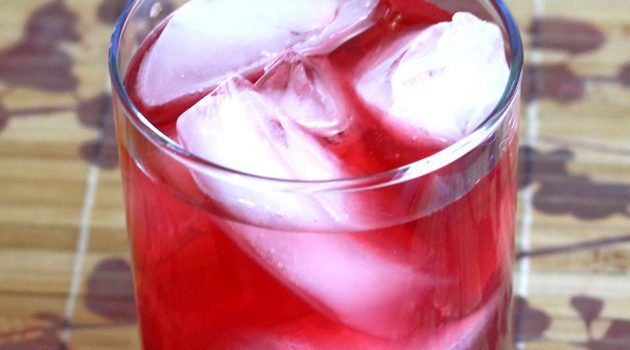 Bright red Desert Shield cocktail on placemat