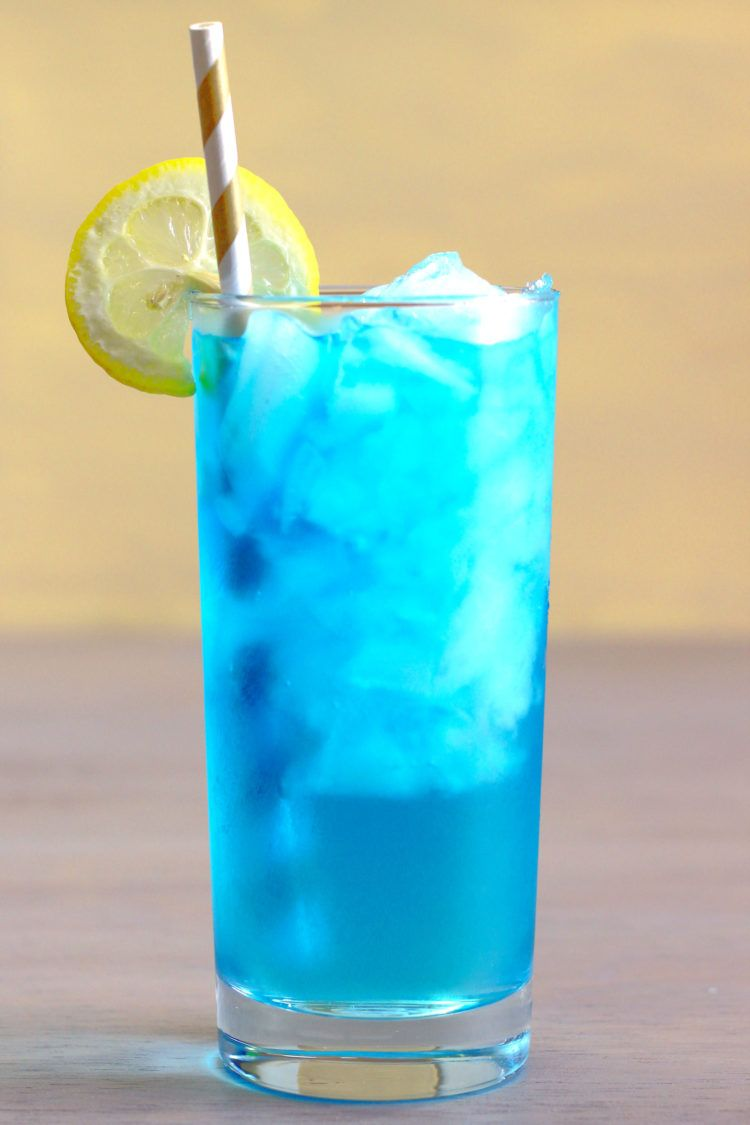 Bight blue Sex in the Driveway drink in a tall glass with lemon and a straw