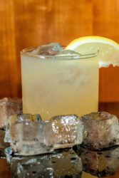 Dickelade drink surrounded by ice cubes