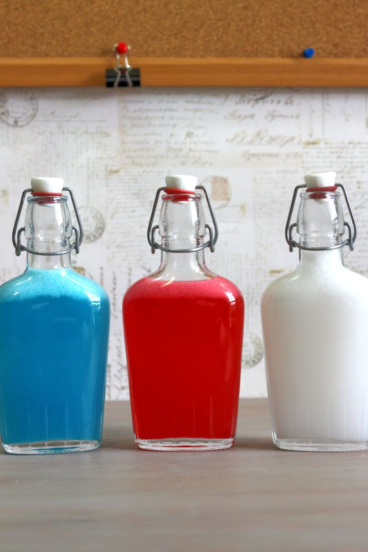Red, white and blue Independence Day Skittles Vodka in a different flask for each color