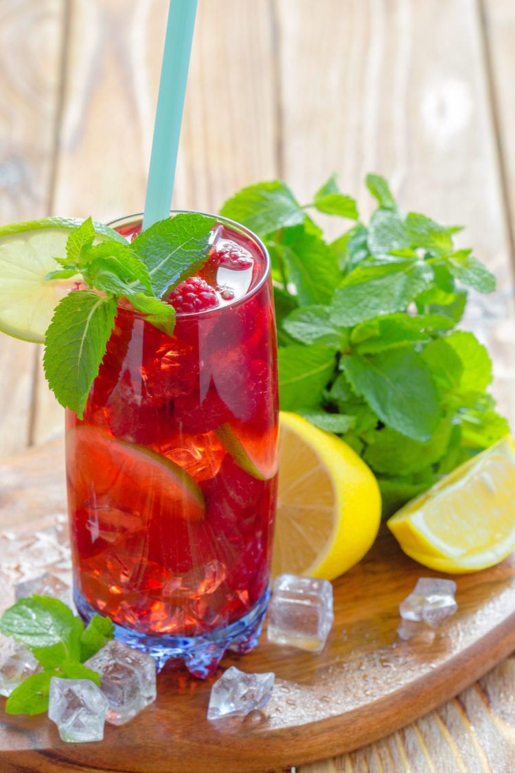 Long Beach Iced Tea with raspberries, mint and lime garnish