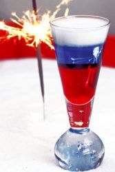Fourth of July layered cocktail with sparkler