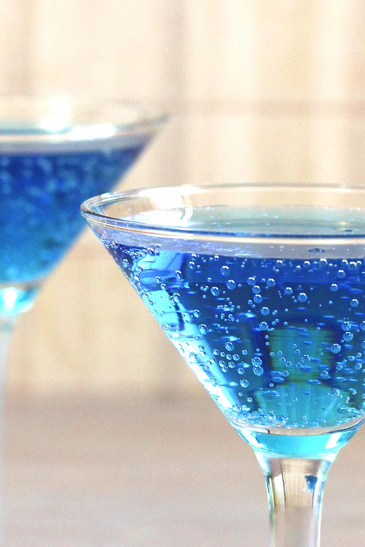 Bubbly blue mocktails on table